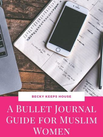 An iphone on a Bullet Journal next to a laptop with the words A Bullet Journal Guide for Muslim Women.