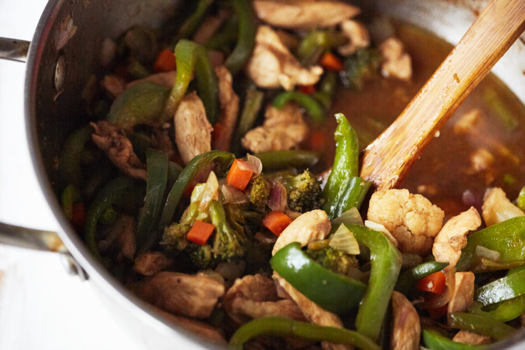 Chicken and vegetables that have been stir fried before adding the noodles.